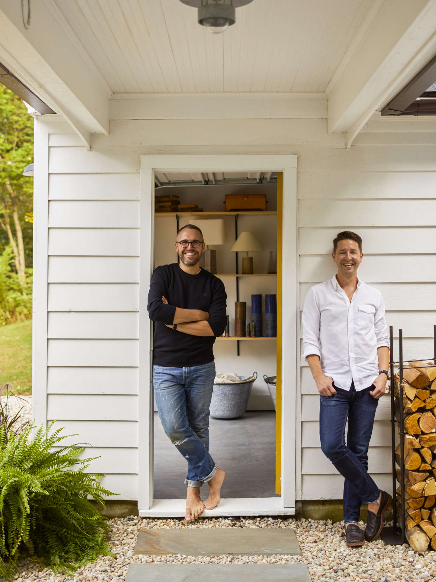 Charlie (L) and Keven (R) in the breezeway that links the kitchen door to the garage that they converted into Charlie&#8
