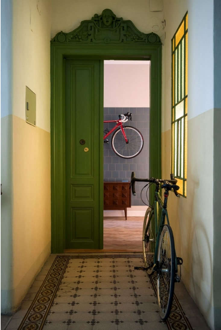 City Slick A Cool Apartment for a Couple Who Lives and Breathes Urban Life The \1,033 square foot apartment is housed in a gracious early \20th century building. The chartreuse front door hints at the bold use of color inside the home.