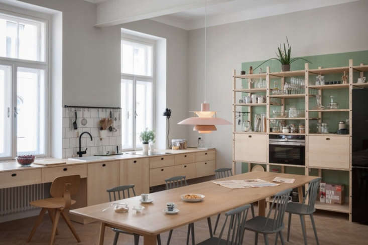 City Slick A Cool Apartment for a Couple Who Lives and Breathes Urban Life The largest room is the kitchen, which the couple also uses as an office and meeting space. &#8\2\20;The kitchen is completely custom; ash wood was used for the cabinets and shelving,&#8\2\2\1; says Blaž.