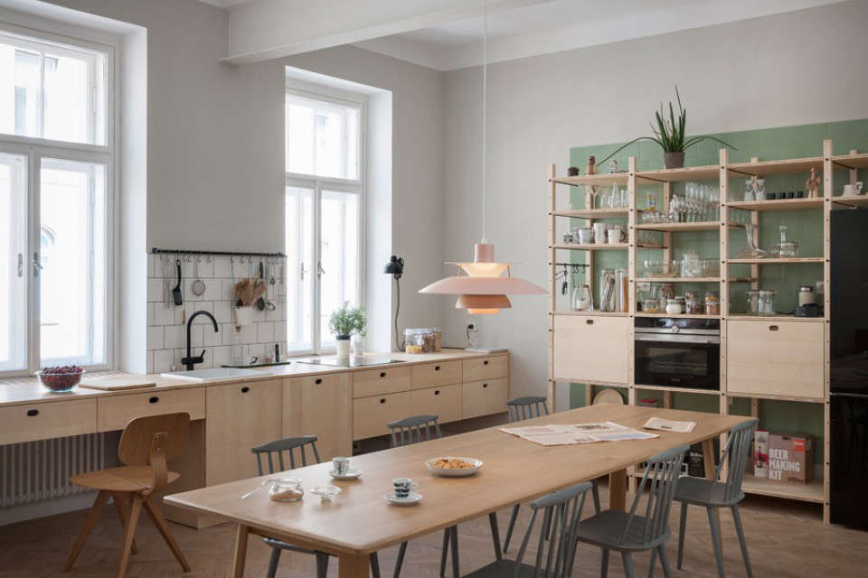 The largest room is the kitchen, which the couple also uses as an office and meeting space. &#8