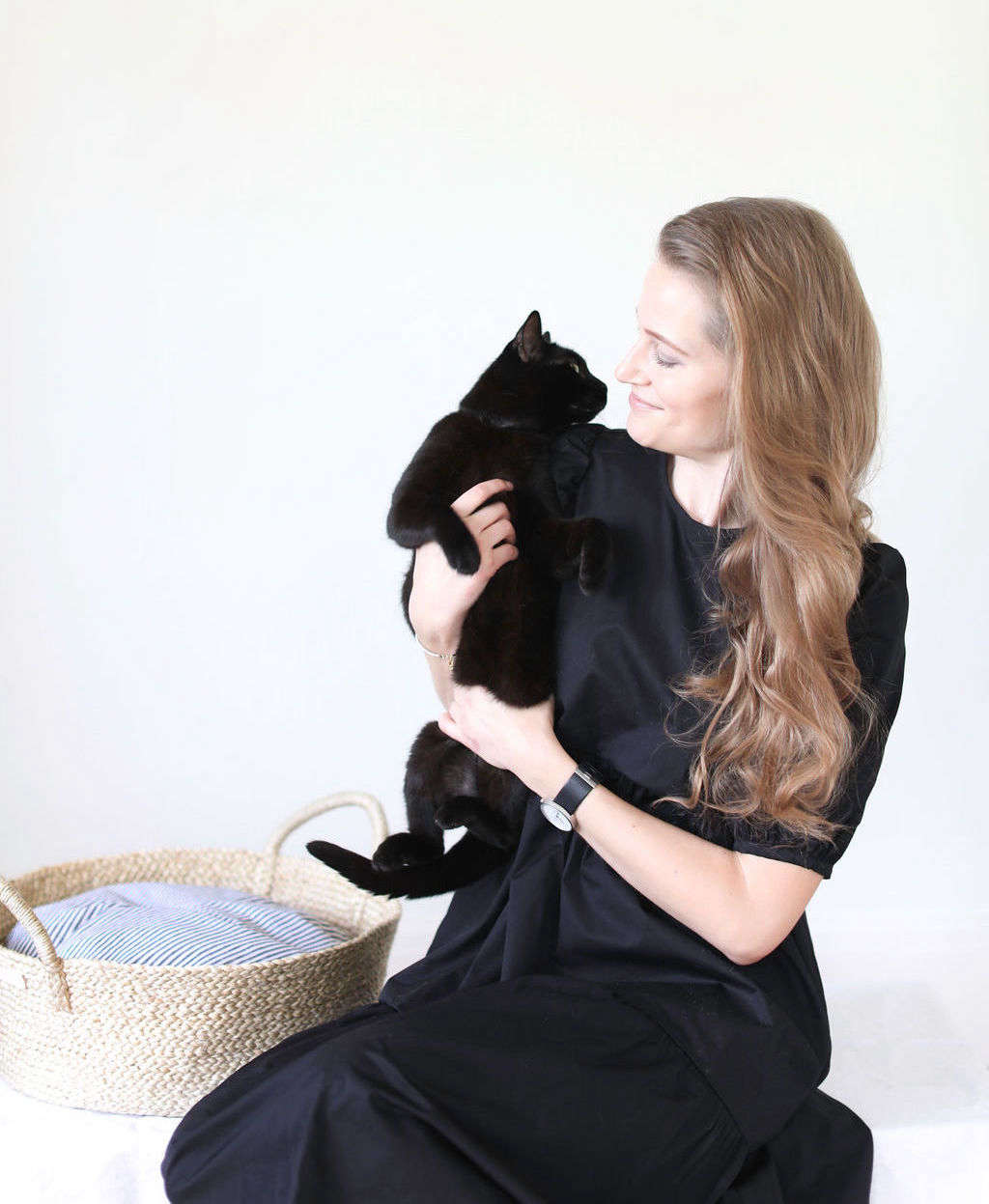Remodelista editor Meredith Swinehart and cat with Faunamade basket bed for pets