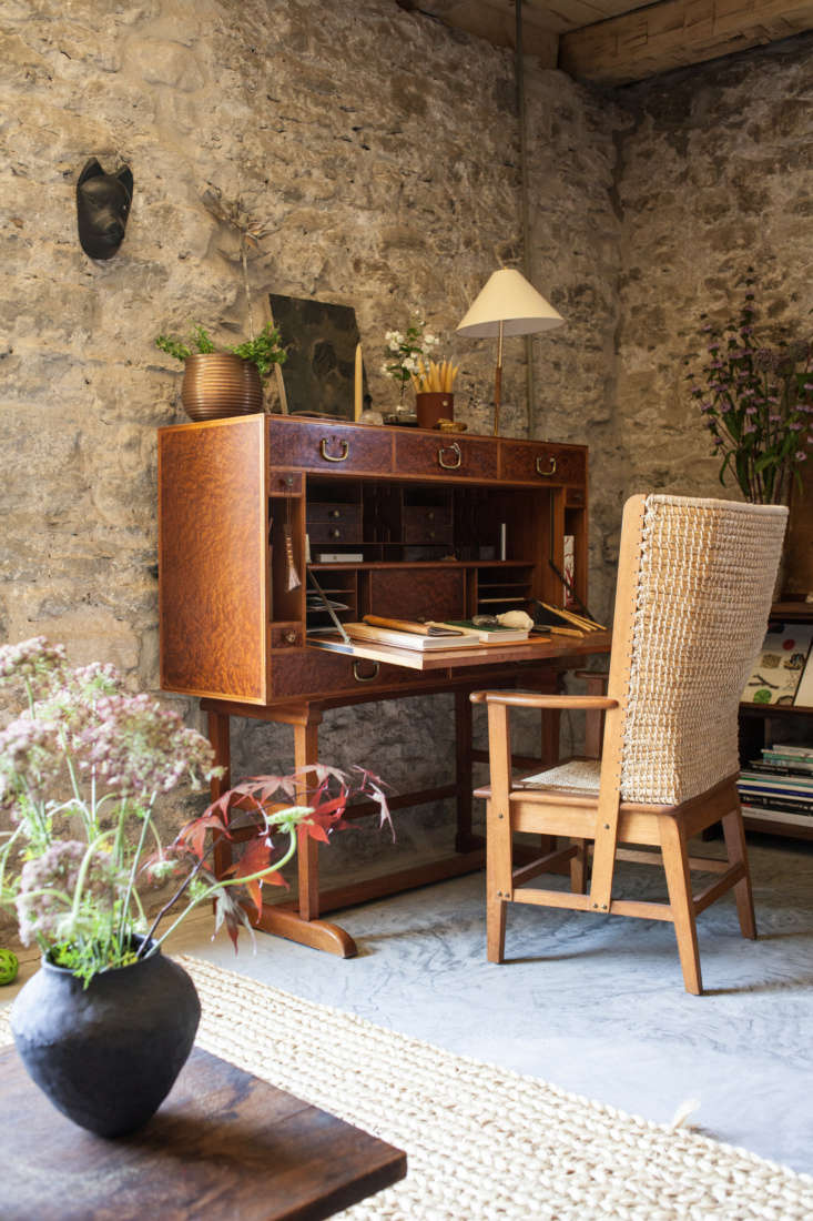 Flowers and greenery animate the study, featuring a Josef Frank Secretaire, of John and Juli Baker&#8