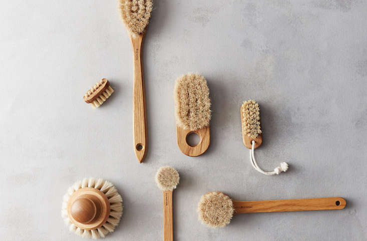 The Oak Handheld Bath Brush by Iris Hantverk (center) is $ at Terrain.