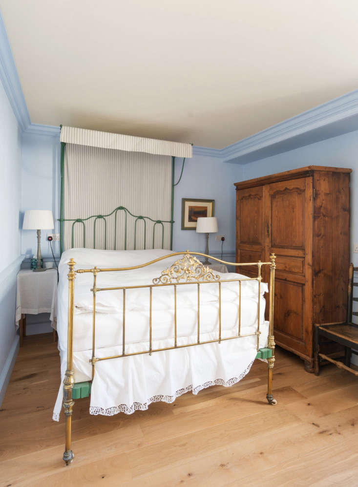 A second bedroom on the second floor has walls painted a cornflower blue.
