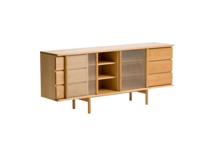 The Ariake Rikyu Sideboard Oak is inspired by stilt houses and the sliding tatami doors of traditional Japanese architecture. Made of matt lacquered oak, the sideboard is $3,88loading=