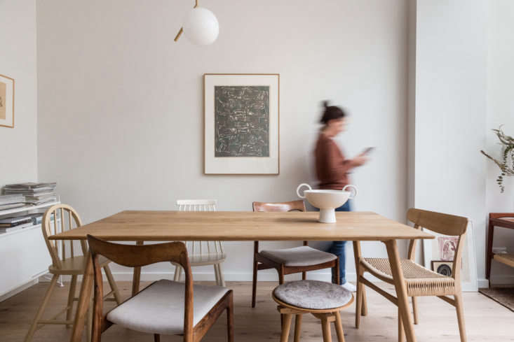 The new dining area features charmingly mixed-and-matched chairs.