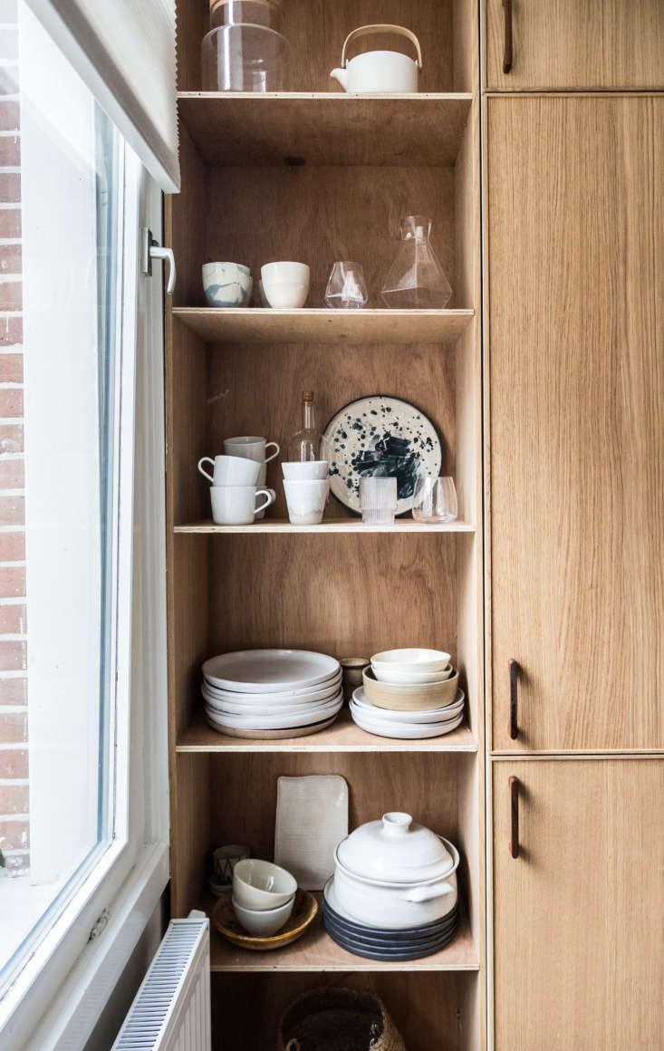The shelves make a perfect spot to store ceramics.