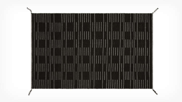 Finally, theMystic Rug is completely reversible (black on one side, cream on the other), with braided tassels on each corner ($639.99 for the 9&#