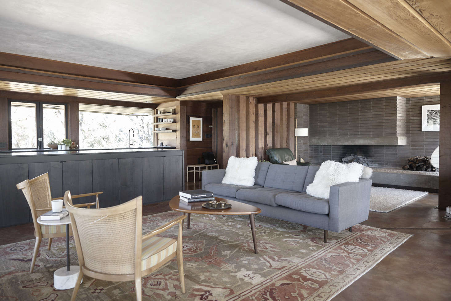 Janet found the vintage Paul McCobb sofa on Chairishand the vintage teak cane-backed Paul McCobb lounge chairs on src=