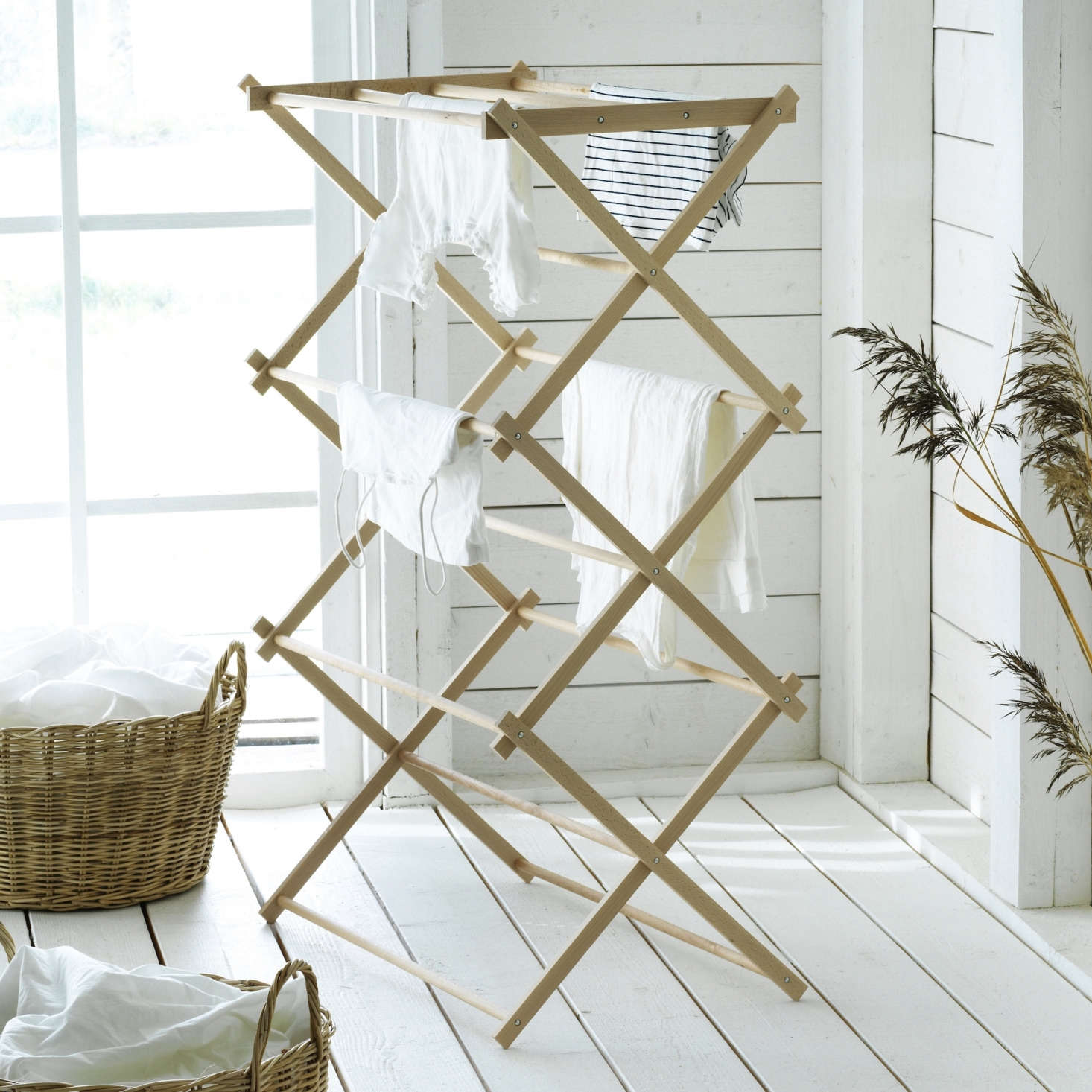 The Borstad line includes laundry solutions like a solid beech Drying Rack ($34.99) and a Basket with Handles ($.99).