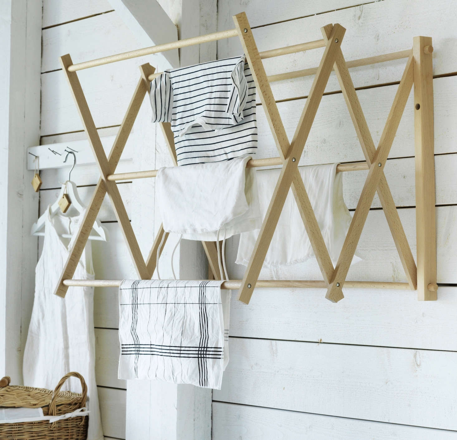 The Wall Drying Rack is $34.99 and the Laundry Basket is $39.99. Hanging on the bottom rung is a Cleaning Cloth from the collection ($5.99 for