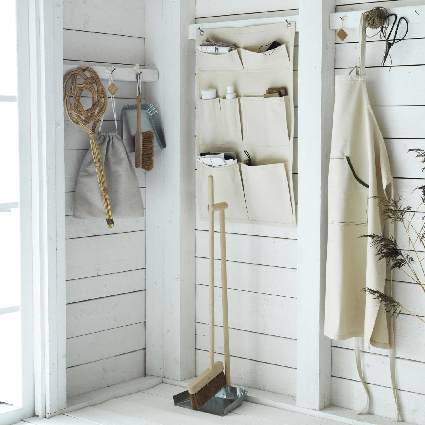 The products in the Borstad line are all made from natural materials such as hardwood, cedar, metal, rattan and canvas. From left: a rattan Carpet Beater ($5.99), a linen Shoe Bag ($4.99), a Dust Pan and Brush ($src=