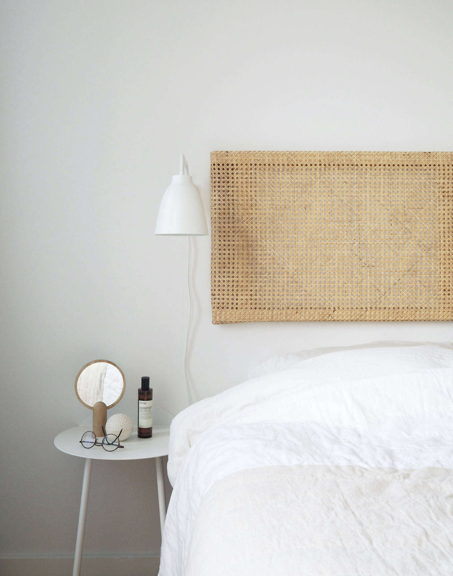 Copenhagen-based interior stylist and writer Caroline Bahrenscheer of the blog September Edit created this floating Rattan Headboard for her own bedroom.