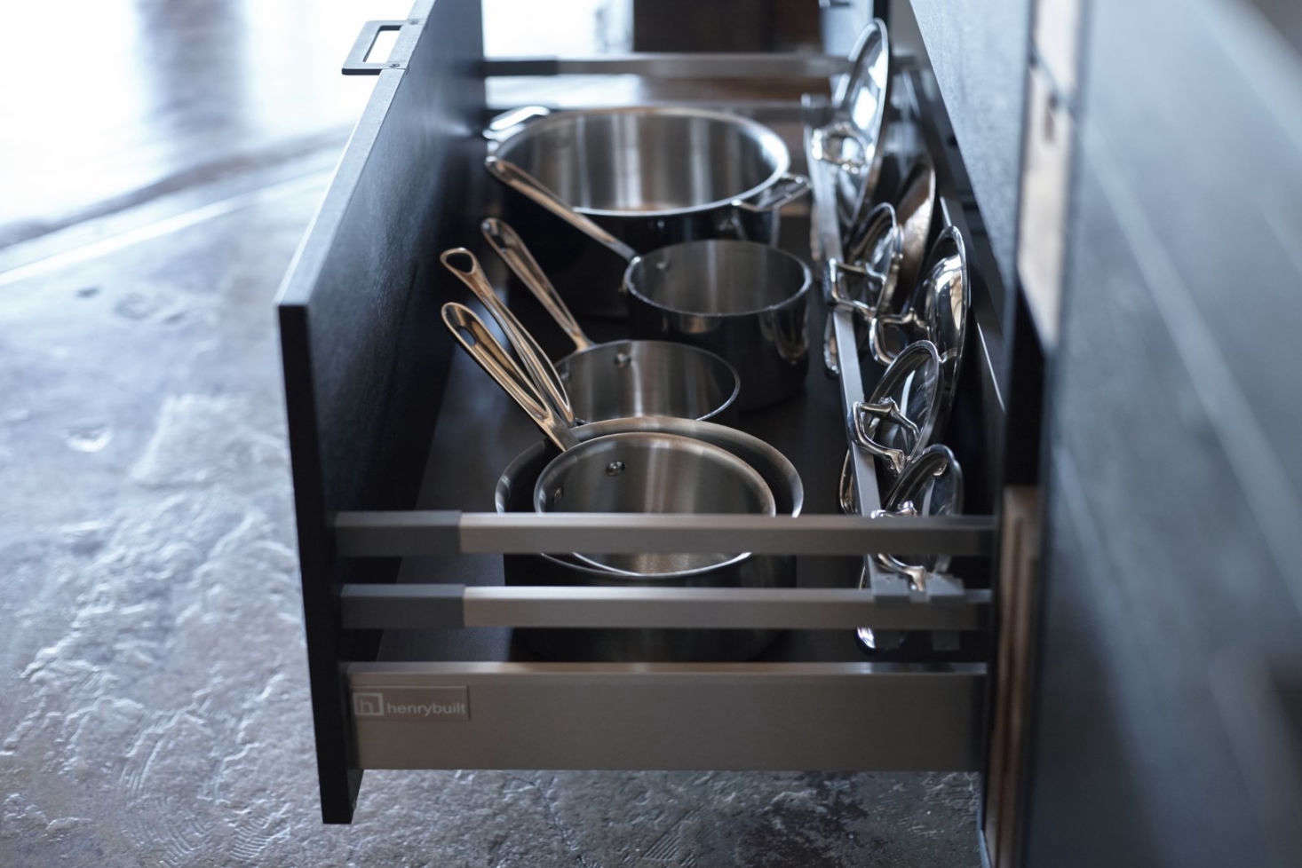 The Henrybuilt system includes deep, eminently practical drawers for pot and lid storage.