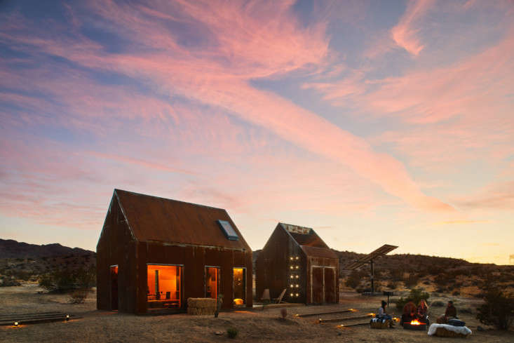 Joshua Tree Folly is entirely powered by solar panels (to the right of the smaller cabin).