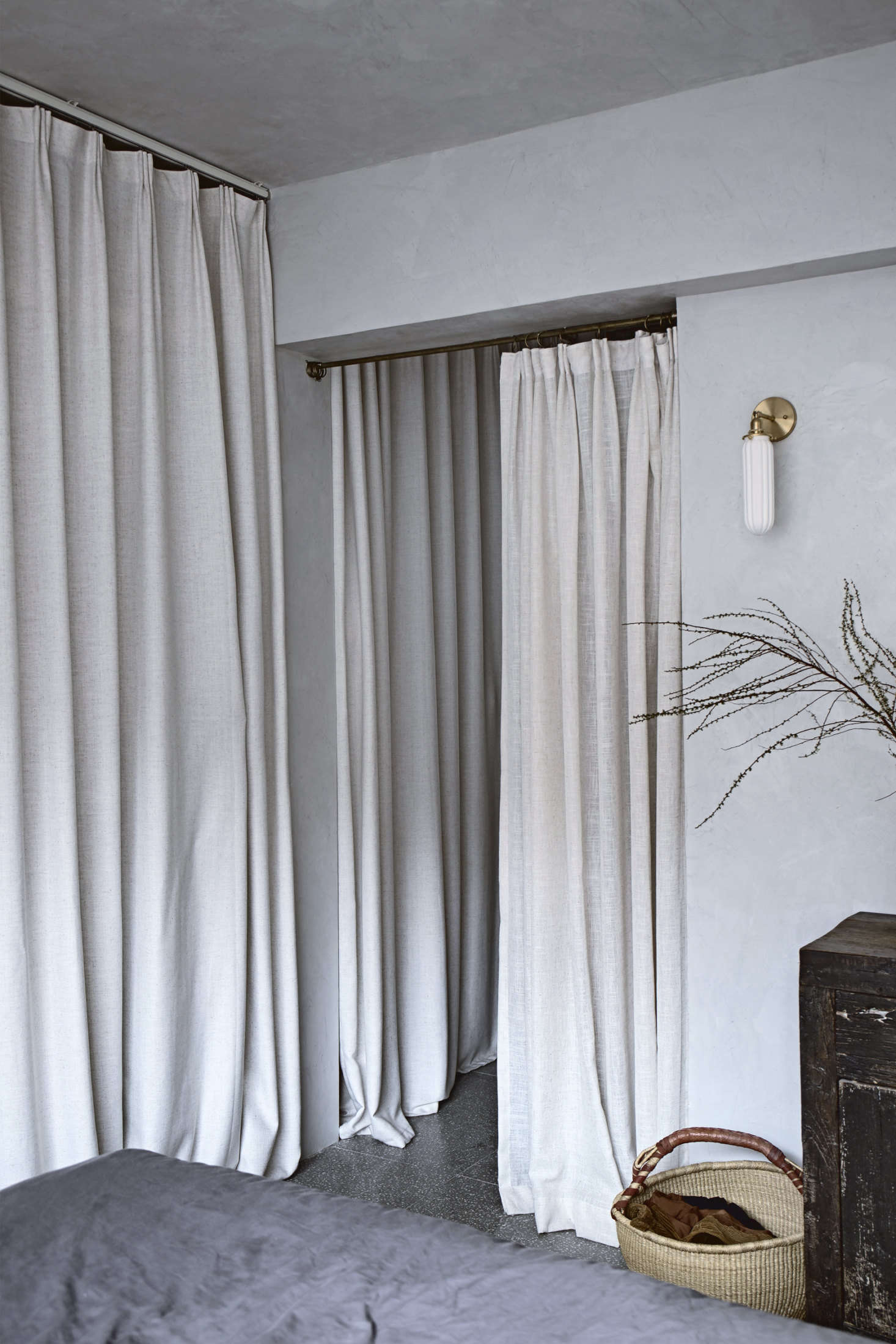 Curtains conceal the walk-in closet. &#8