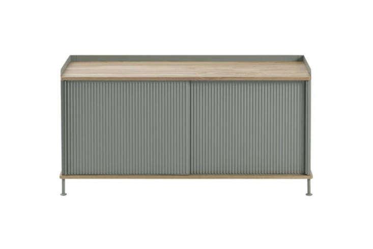 The Muuto Enfold Sideboard Low in Dusty Green Steel, Grey Steel, Black Steel, and Sand Yellow Steel; $