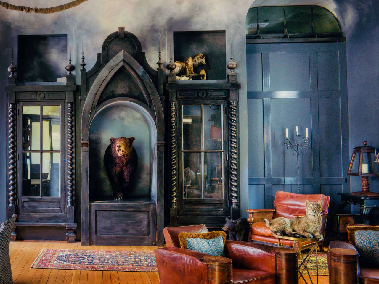 The great room is filled with curiosities, including a taxidermy bear and bobcat.