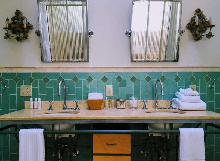 A green-tiled bathroom.