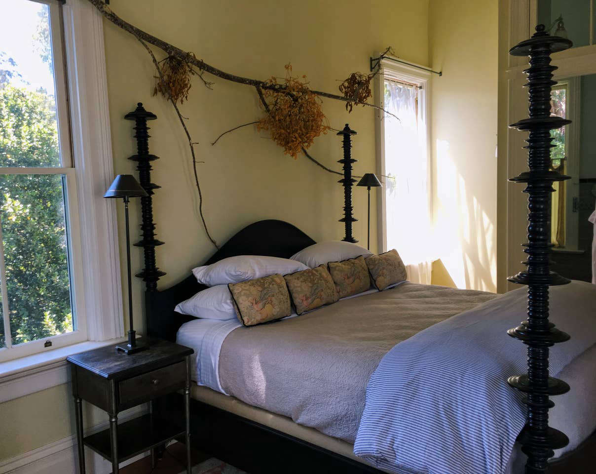 Foraged branches and foliage above the bed in the master suite.