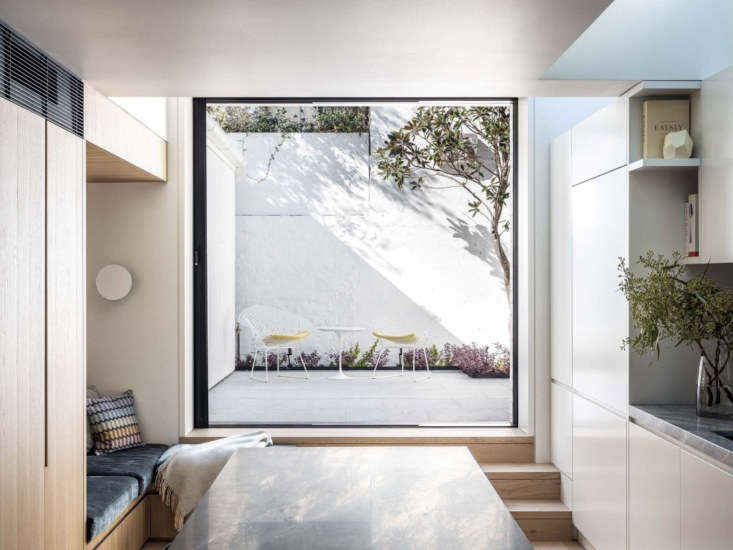 skylights in the kitchen and this oversized glass sliding door offer an abundan 18