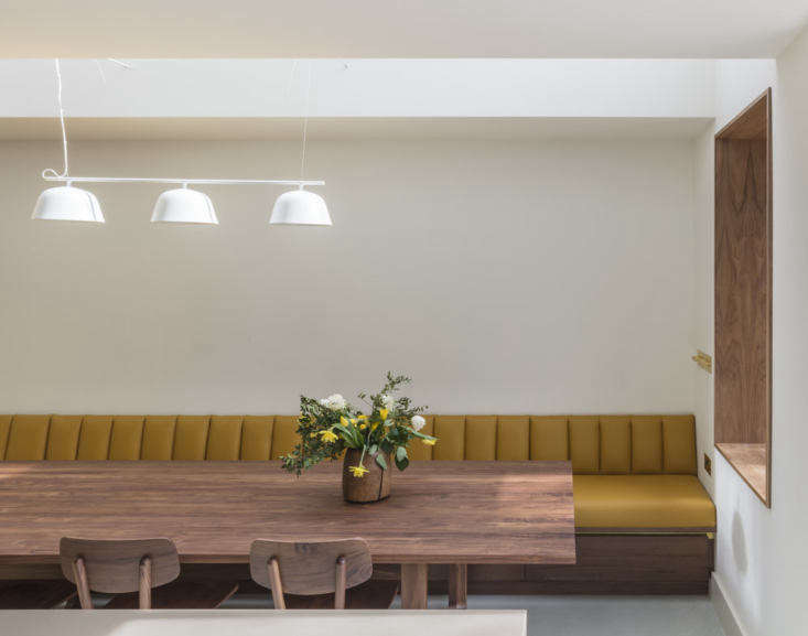 The room is filled with natural light thanks to a long skylight. Muuto&#8