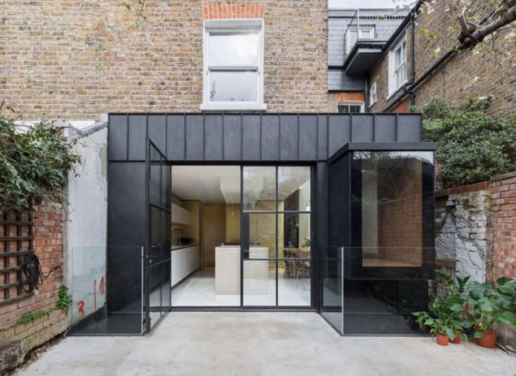 The extension is clad in handmade matte-black steel panels that Astridge says &#8