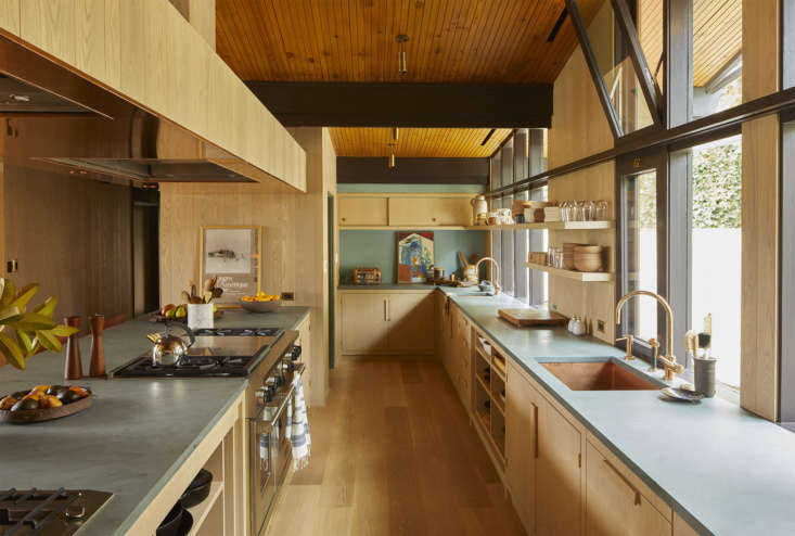 The quasi-galley kitchen features Vermont green slate and raw brass hardware, both of which will develop patina over time, something that Shamshiri, who embraces a wabi-sabi aesthetic, welcomes.
