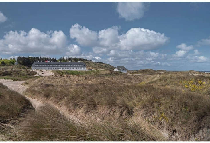 Svinkløv Badehotel is surrounded by sand dunes that lead to the North Sea. The couple decided to rebuild the exterior to look the way it did before the fire.