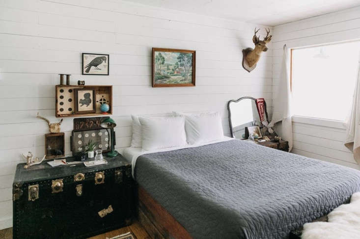 The trunks serve as bedside tables (and extra bedding storage) at the Red Rose.