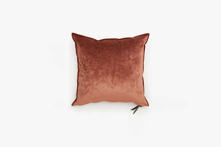 The Maison de Vacances Royal Velvet Pillow in Clay is made in France and features dark rust piping (and a metallic zipper pull); $5 from ABC Carpet & Home