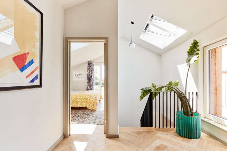 A green storage basket from Milagros used as a planter in a Charlie Luxton-designed home. Photograph by Ed RS Aves, courtesy of Charlie Luxton Design, from Before & After: An Environmentally Sensitive Rehab of a Cotswold Bungalow.