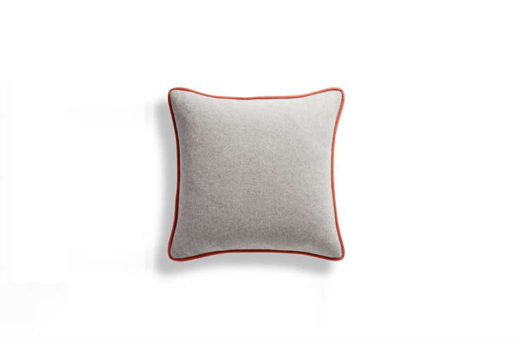 A favorite by Blu Dot: The Duck Duck Wool Feathers Throw Pillow is available in a multitude of three-tone color ways (in addition to having contrasting piping, the two sides are also different colors). This one is light grey with &#8