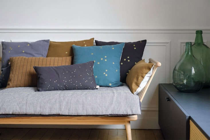 Duvets in Europe tend to be smaller in size. French store Smallable carries quilts for single beds that can double as throwbeds. This Ernest Eiderdown Quilt by Cerise Sur le Gateau is $0.