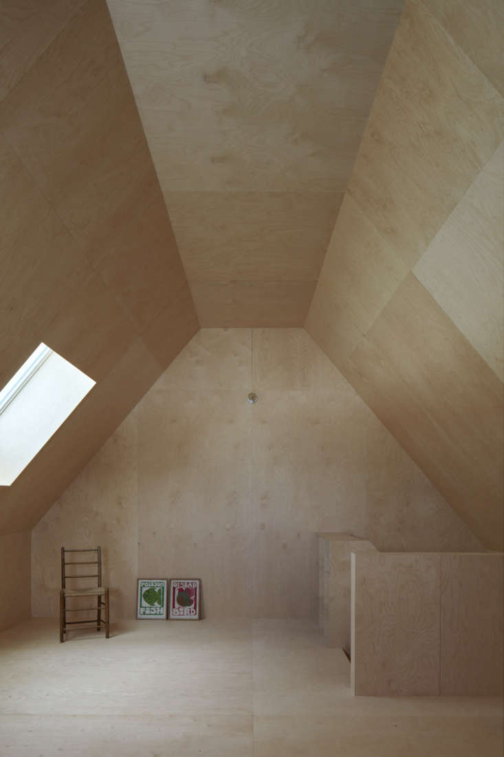 Patterned by plywood squares, the room is used as a work and play space. There are also two bedrooms and a bath in this wing.