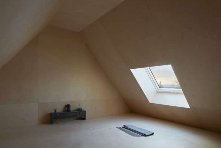 Narrow stairs behind the master bed lead to the birch-plywood-lined meditation room, &#8