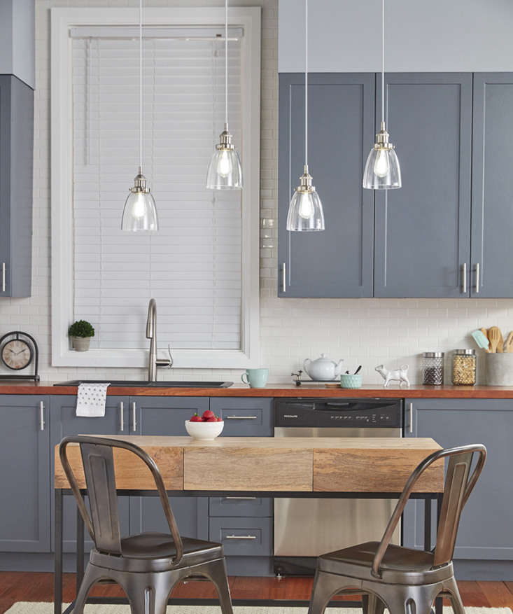 Four Fiorentino Industrial Factory Pendant Lights ($39.99 each)—staggered and hung in a row—frame a petite breakfast table.