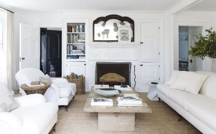 The living room is furnished with a trio of upholstered pieces from Ralph Lauren Home that are typically occupied by Charlie and Sam, the cats, and Ruby, the dog. Mark says the wood coffee table from Démiurge is what made the room feel finished.