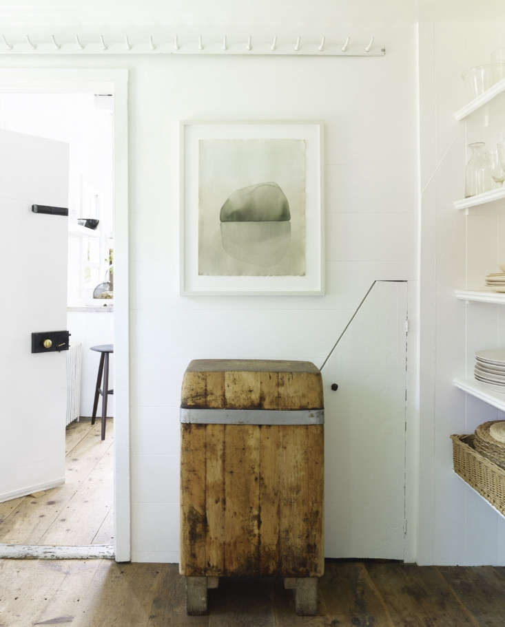 A narrow pantry divides the kitchen from the dining room. A row of butcher&#8