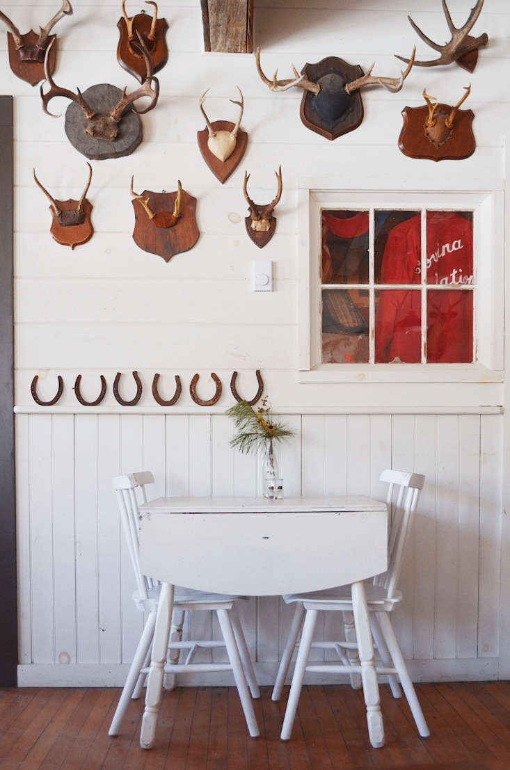 A painted table for two at the Red Rose tavern. The collection of mounted antlers were gathered over time on Craigslist.