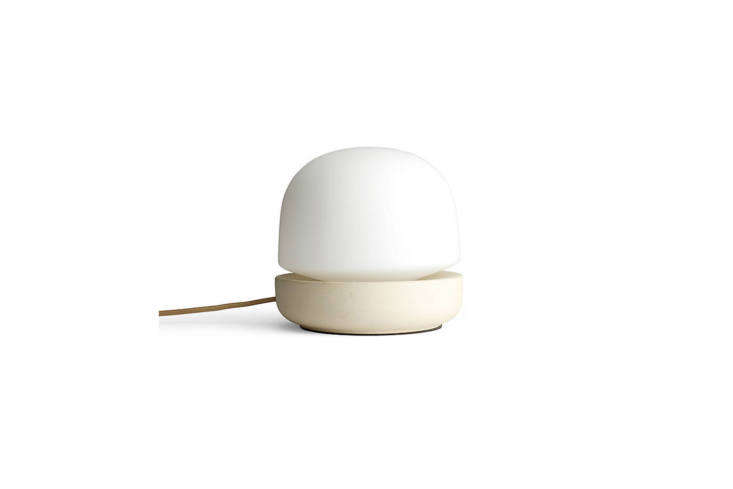 designed by norm architects for menu, the stone table lamp is made with cream c 10