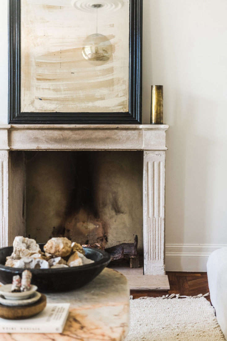 The couple imported two th-century stone mantels from France. &#8