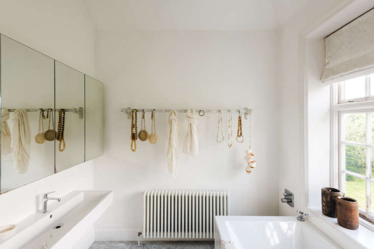 Accessories hang from vintage ceramic butcher&#8