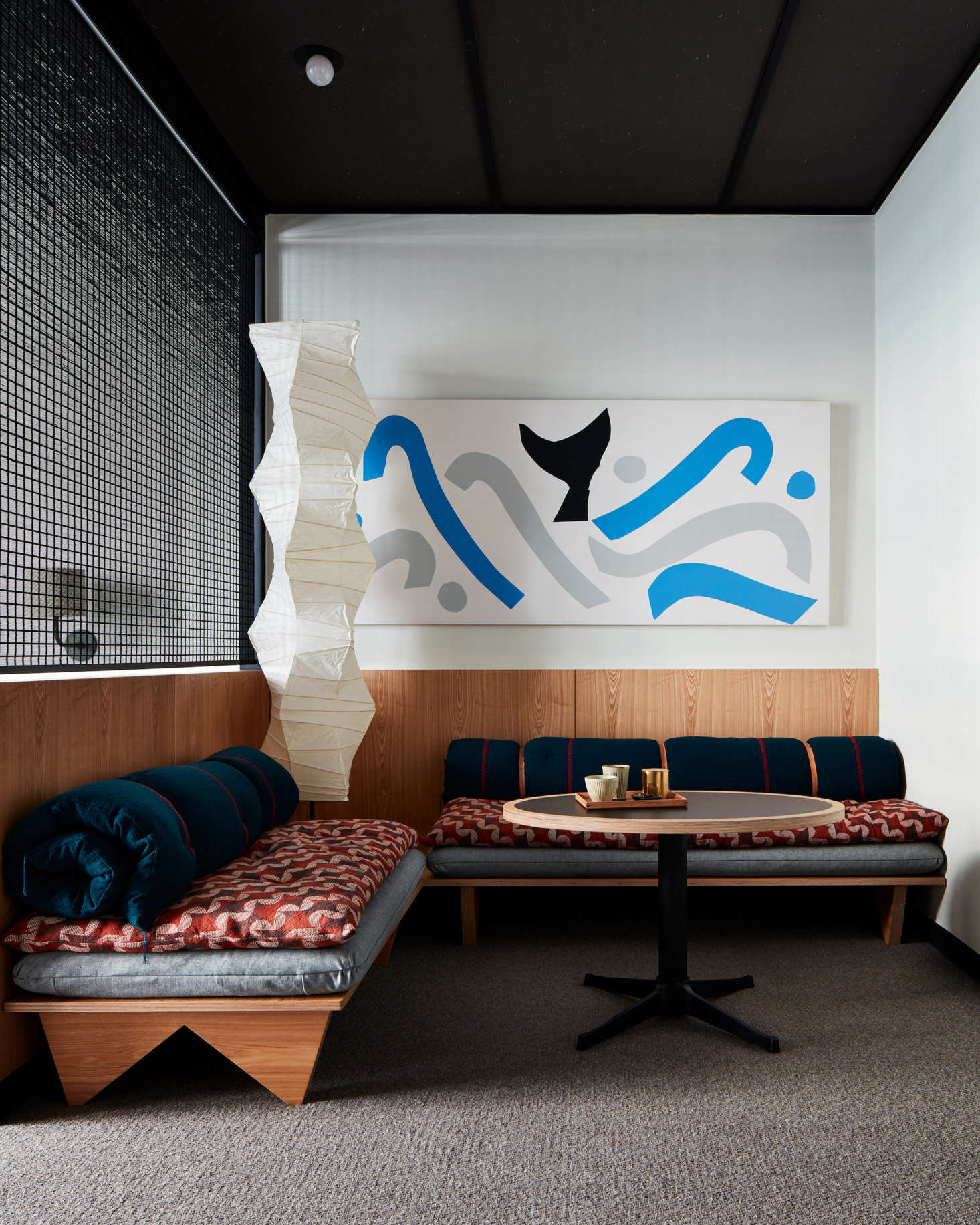 Art by local artists is displayed throughout the hotel. A classic Akari Noguchi floor lamp presides over the sitting area of a guest room. (See src=