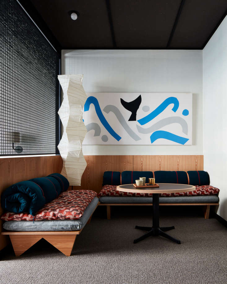 Art by local artists is displayed throughout the hotel. A classic Akari Noguchi floor lamp presides over the sitting area of a guest room. (See loading=