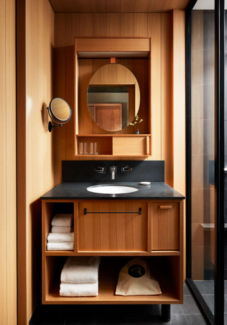 the wood clad bathroom. most bathrooms in the hotel also have a traditional jap 15