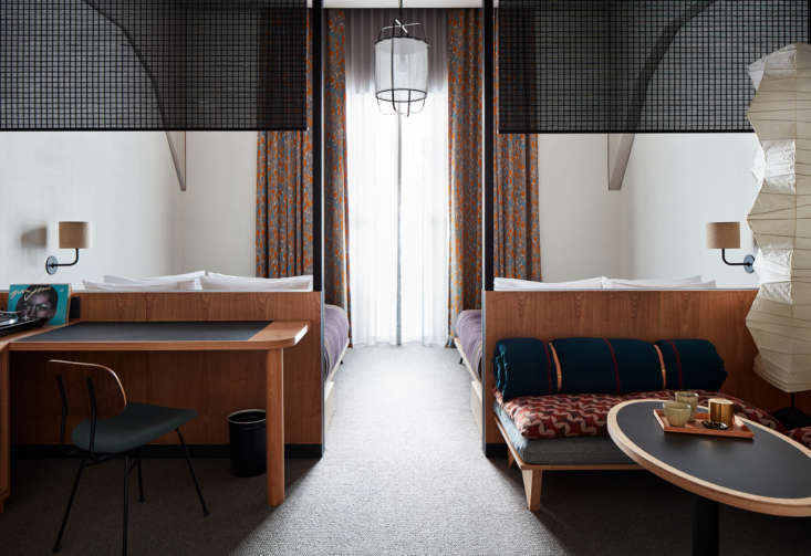 Two Japanese bamboo sudare shades divide the sleeping quarters from the living area.
