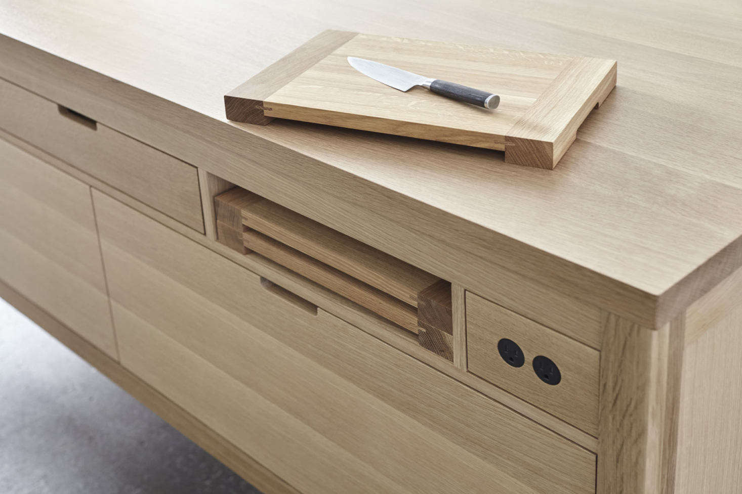 When not in use, the cutting boards are tucked away in an easy-to-reach niche.
