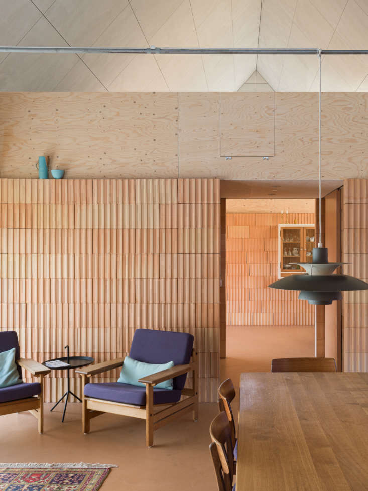 the open living, dining, and kitchen space. insulating textured clay blocks for 11