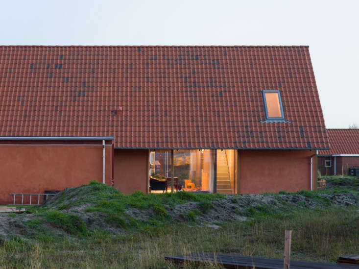 the exterior was painted a terracotta color to coordinate with the steeply pitc 9